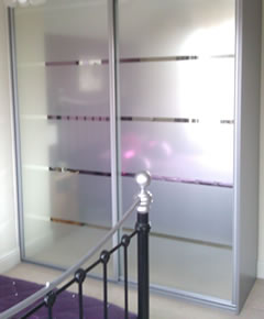 Chrome framed wardrobe with acid etched doors