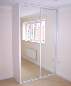 White framed wardrobe with white end panels and mirror